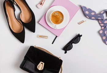 Creative compositioun with coffe and stylish feminine accessories