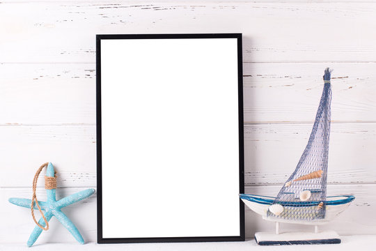 Empty  black frame mockup  with copy space and  summer sea vacation  decorations