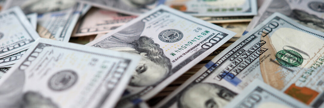 Huge amount of US bucks lying down at table