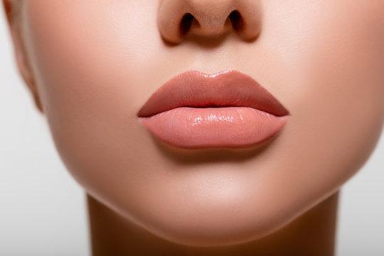 Beautiful lips macro. Beauty. mouth. makeup. Closeup Model Peach Color in Studio. - image