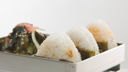 metal bento with onigiri and salad