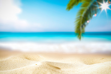 Summer background of hot sand with free space for your decoration and blurred background of ocean...