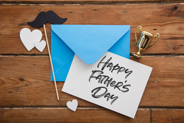 Father's day card and envelope with trophy, mustache and hearts