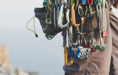 Rock climbing gear attached to harness Fototapete