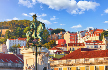Lisbon, Portugal. King Jose I Statue at Praca do Comercio waterfront. Old town of Lisboa in historic midtown Alfama district. Evening sunset and blue sky with clouds.