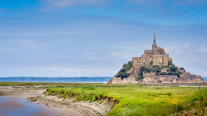 Panoramic view of Le Mont Saint Michel castle on the cliffs, best touristic travel destination in Normandy, France, Europe