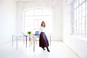 Full length shot of attractive mature businesswoman standing in the office Wall mural