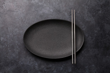 Empty plate and chopsticks