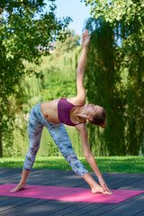 Woman practicing yoga outdoor