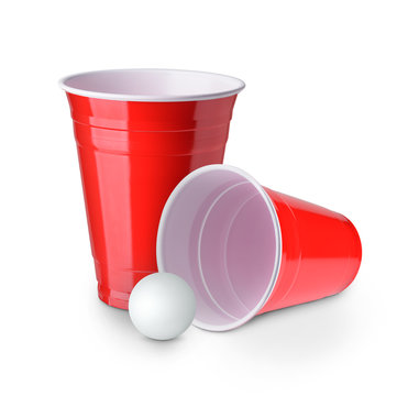 Beer pong. Red plastic cups and ping pong ball solated on white background