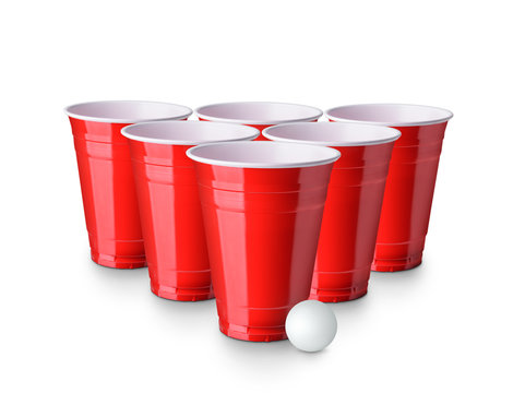 Red Beer Pong plastic cups with ball isolated on white background. Traditional drinking game