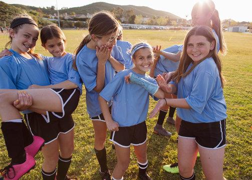 Girls enjoying on soccer field