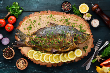 Baked Fish Carp with Vegetables. Top view. Free space for your text. Rustic style.