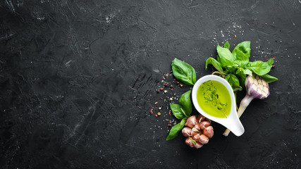 Fotomurales - Olive oil and herbs. On a wooden background. Top view. Free space for your text.