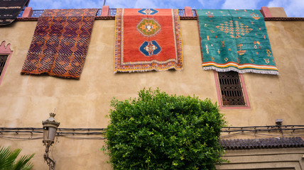 Morocco, Marrakesh, carpets hanging from a wall