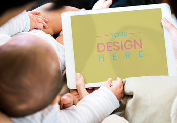 Parents Using Tablet with Their Baby Mockup