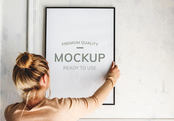 Woman Hanging a Frame Mockup
