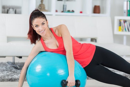 woman doing exercise routine with gym ball