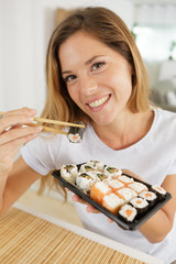 picture of woman eating sushi