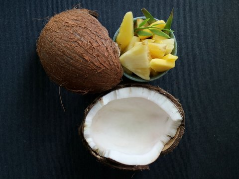 Coconut, mango and pineapple in a bowl