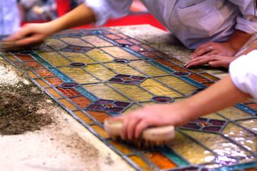 Artisans brush art stained windows