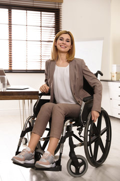 Portrait of woman in wheelchair at workplace
