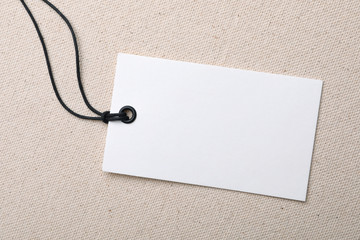 Cardboard tag with space for text on color fabric, top view