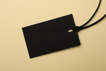 Cardboard tag with space for text on color background, top view