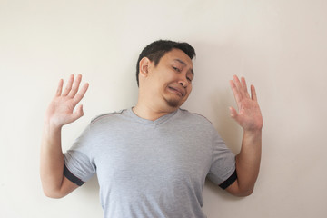 Young Man  Afraid With Arms Raise Up, Surrender Gesture