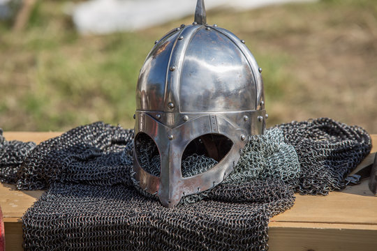 Protective helmet with a visor on medieval knight. European medieval Military.