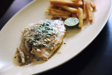 Halibut fillet steak with chips