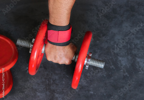 Man hand hold red dumbbells in gym  Equipment for weight