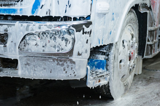 The element of the cab of the blue truck in the lather during washing.