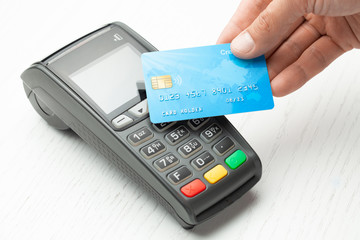Contactless payment by credit card. POS terminal NFC payment. Concept of how to choose payment method for shopping in a store.