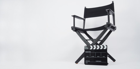 Black Clapper board or movie slate with director chair use in video production or movie and cinema industry. It's put on white background.