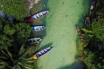 Aerial with fishing boats on White River, Jamaica
