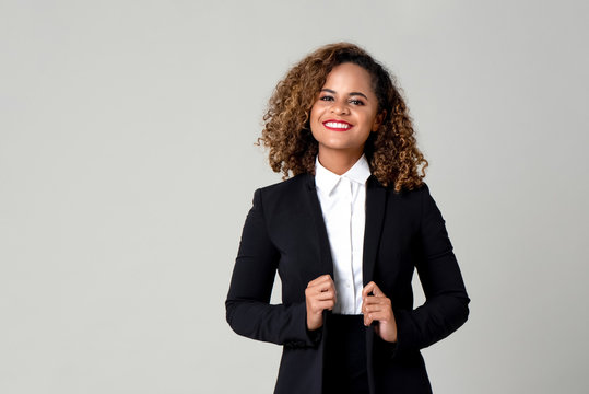 Happy smiling African American woman in formal business attire