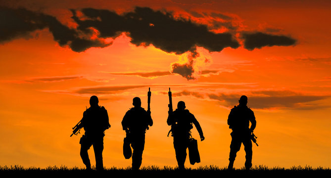 Navy seal silhouettes  on sunrise