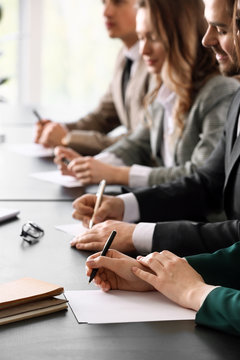 Human resources commission sitting at table in office during job interview