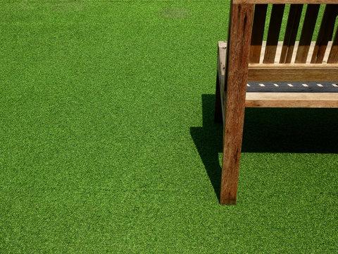 Wooden chair on artificial grass in garden