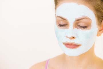 Girl with green mud mask on face