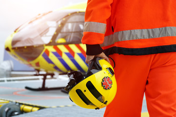 Doctor of an air ambulance in front of a rescue helicopter for an emergency operation