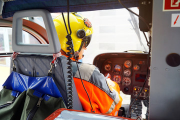 doctor of an air ambulance as a co-pilot on board a rescue helicopter in a emergency operation