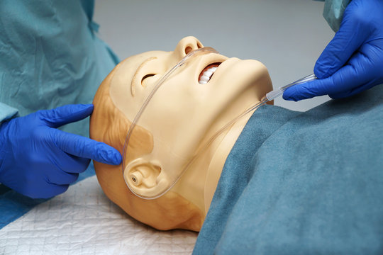 Doctor shows the use of a laryngeal mask airway using a medical patient simulator in the operating room of a hospital