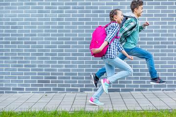 Teen boy and girl back to school