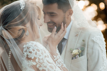 wedding couple in love looks one-on-one