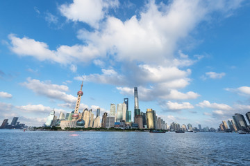 Fotobehang - shanghai skyline against a sunny sky