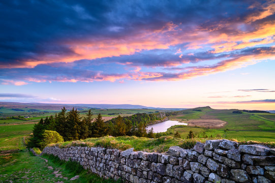 Crag Lough and Hadrian's Wall at Sunset, a UNESCO World Heritage Site in the beautiful Northumberland National Park. popular with walkers along the Hadrian's Wall Path and Pennine Way