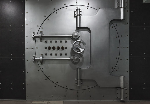 Closed steel bank vault door, close-up. Bank vault.