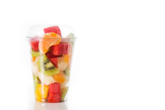 Fresh cut fruit in a plastic cup isolated on white background